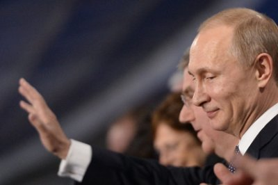 Путин вручил российским медалистам Олимпиады ордена и медали